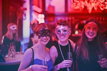 People at a masquerade ball